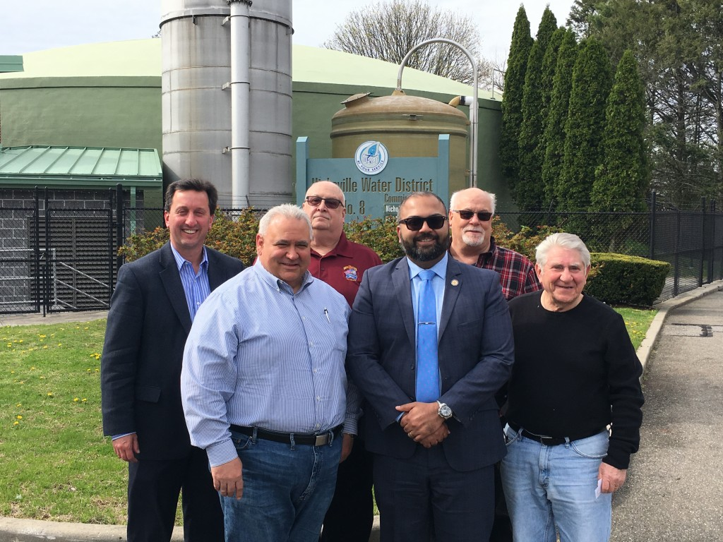(L to R) Hicksville Water District Engineer of Record, Rich Humann, Commissioner Karl Schweitzer, Commissioner William Schuckmann, New York State Senator Kevin Thomas, Hicksville Water District Interim Superintendent Ken Claus and Commissioner Nicholas Brigandi pose for a photo outside of HWD Plant 8.