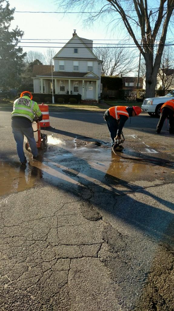 Hicksville Water District crews work diligently to repair a water main break.